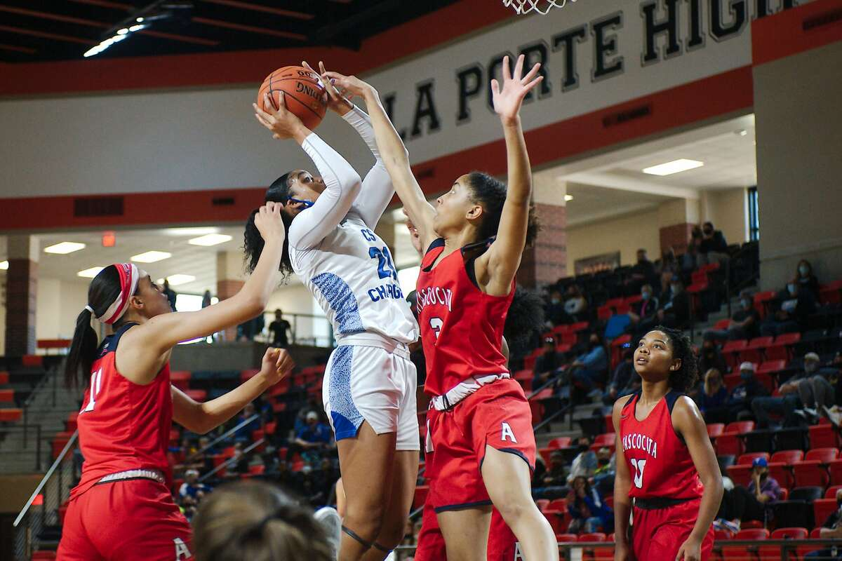 Clear Springs' Niyah Johnson (21) tries to put up a shot over Atascocita's Kori Fenner (3) Saturday, Feb. 20 at La Porte High School.