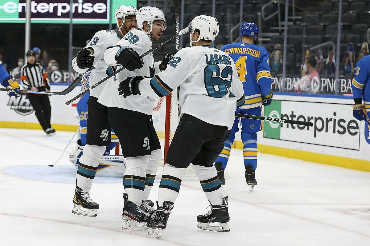 The Sharks' Logan Couture (39) is congratulated by teammates Evander Kane (left) and Kevin Labanc after a first-period goal.