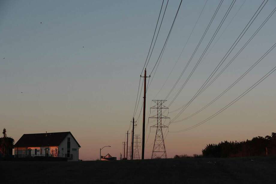 AUSTIN, TEXAS - FEBRUARY 19: Electric power lines run through a neighborhood on February 19, 2021 in Austin, Texas. Amid days of nationwide frigid winter storms in which 58 people died, more than 4 million Texans were without power for much of the past week, with about 13 million Texans being forced to boil tap water in the aftermath of the strain on infrastructure. (Photo by Joe Raedle/Getty Images) Photo: Joe Raedle, Staff / Getty Images / 2021 Getty Images