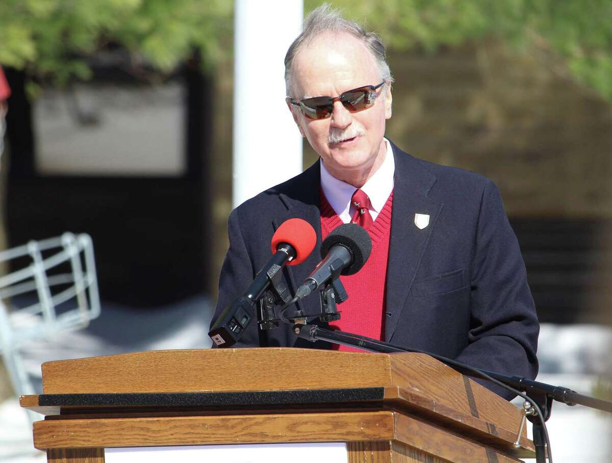 Fairfield University Assistant Vice President of Administration and Student Affairs James Fitzpatrick, Class of 1970, gives opening remarks at a 75th anniversary flag raising on March 17, 2017 in Fairfield, Conn.