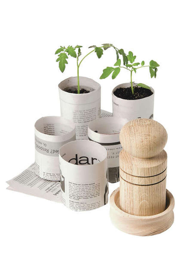 Paper pot makers make it easy to transform newspaper into biodegradable plant pots that are perfect for starting seeds. Photo: Gardener's Supply Co.