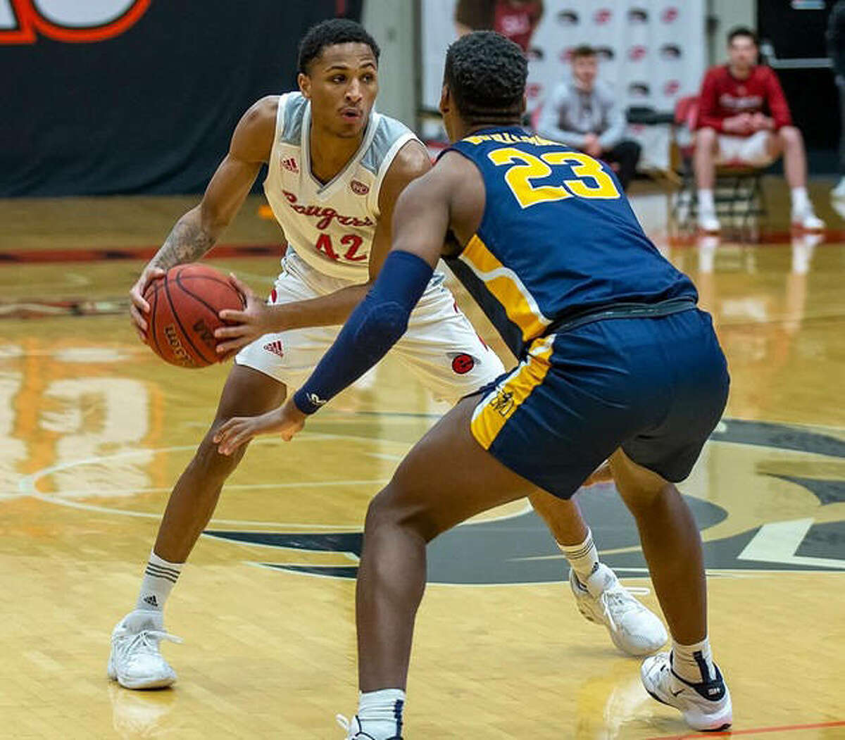 SIUE's Shamar Wright (left) looks to make a move against a Murray State defender during a game earlier this season in Edwardsville. The Cougars were at Murray, Ky., on Saturday and fell to the Racers.