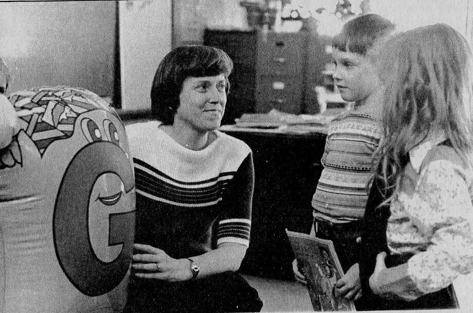 "From the Feb. 20, 1981 issue of the News Advocate, Carl Urbanus, a kindergarten teacher at Bear Lake School, introduces ""Mister G,"" a phonics aid to kindergarteners, Court Oligney (center) and Michelle Royer (right). Urbanus uses the letter people to aid in letter sound and site identification. (Manistee County Historical Museum photo)"