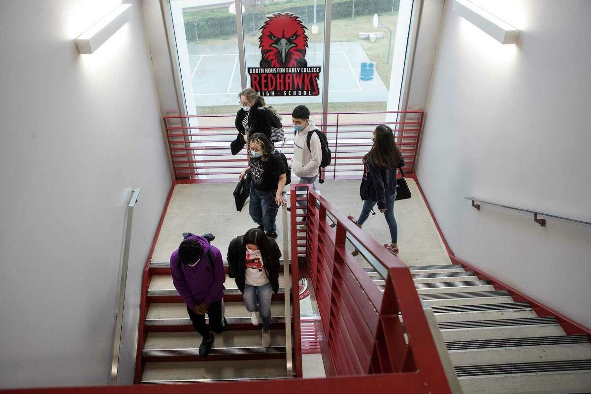 Students walk to their next class Feb. 10 at North Houston Early College High School. Children at Risk's ratings show some campuses handle disruption better.
