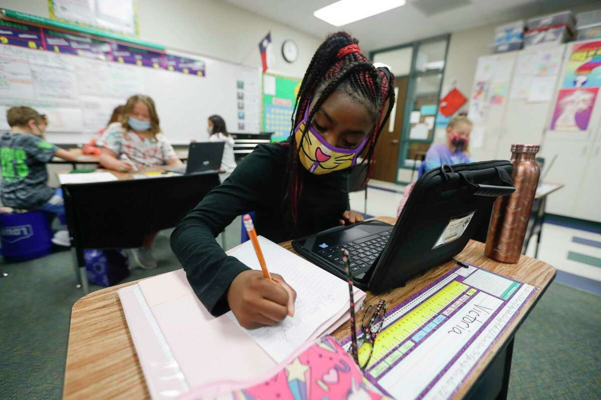 Fifth grader Victoria Thomas uses her laptop to work on math at William Lloyd Meador Elementary School in Willis on Sept. 8.