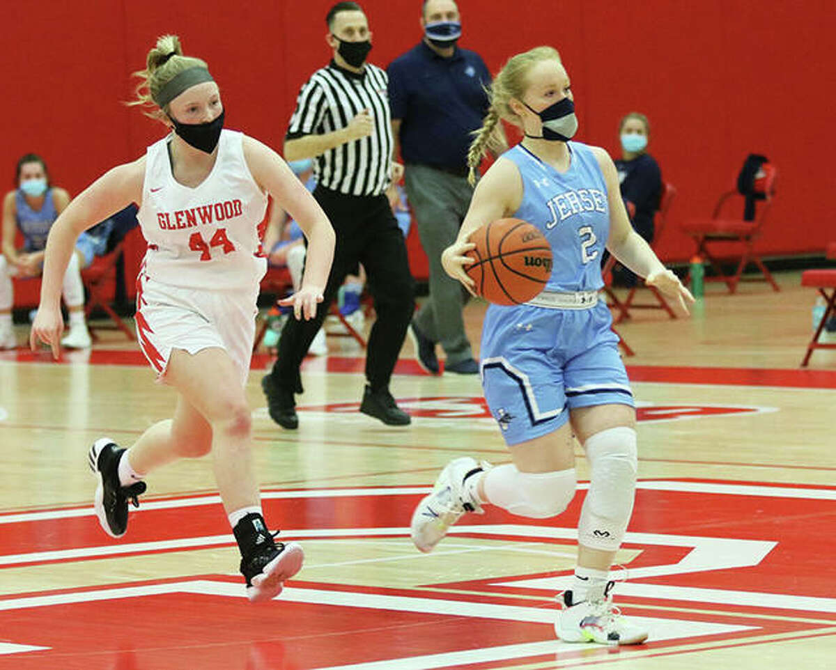 Jersey's Sally Hudson (right), shown pushing the ball upcourt with a Glenwood defender in pursuit in a Feb. 5 game at Chatham, had three 3-pointers and 11 points in the Panthers' MVC win Saturday in Mascoutah.