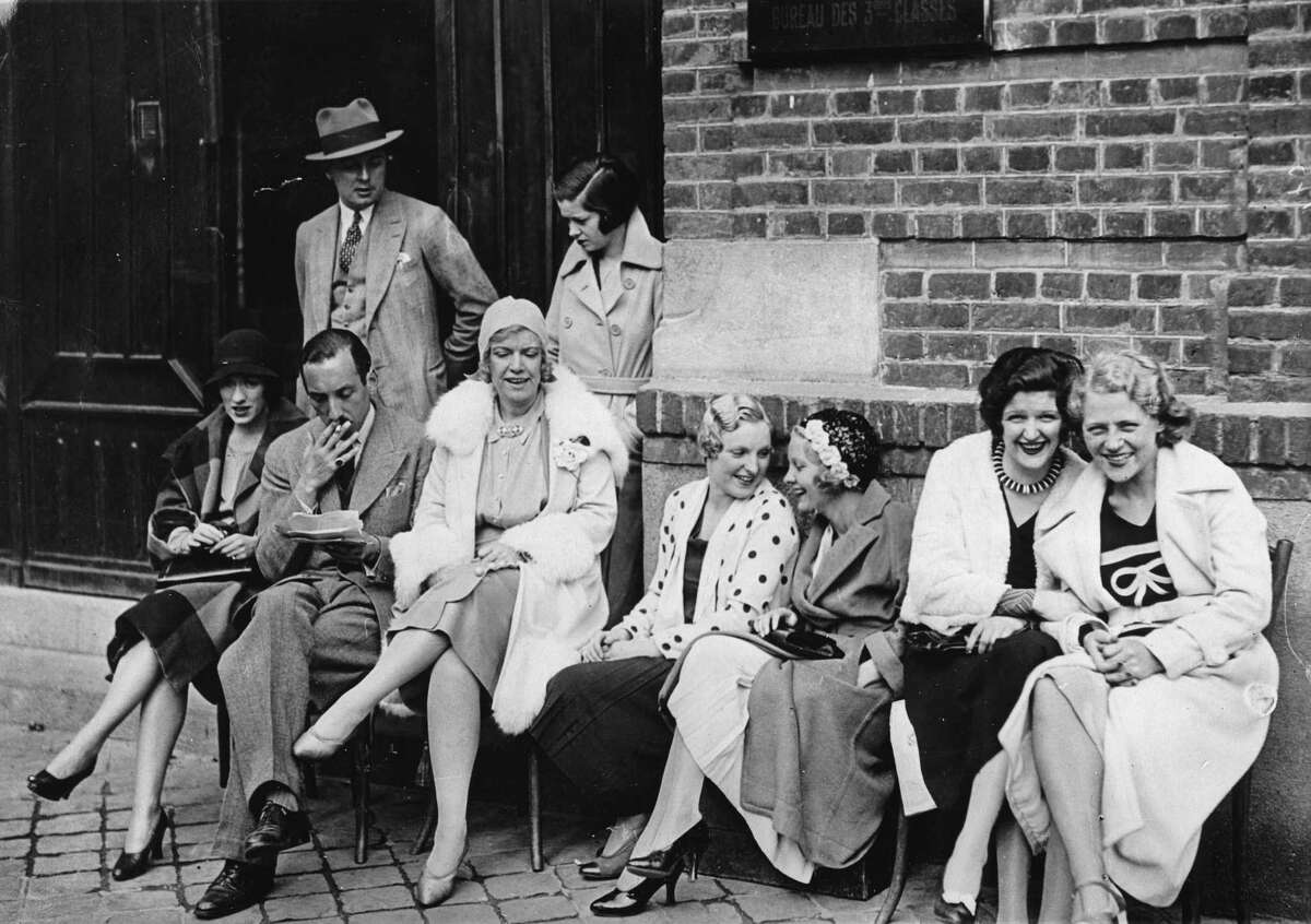 The American actress and nightclub owner Texas Guinan (in white coat) with her girls. Le Havre. 2nd June 1931.