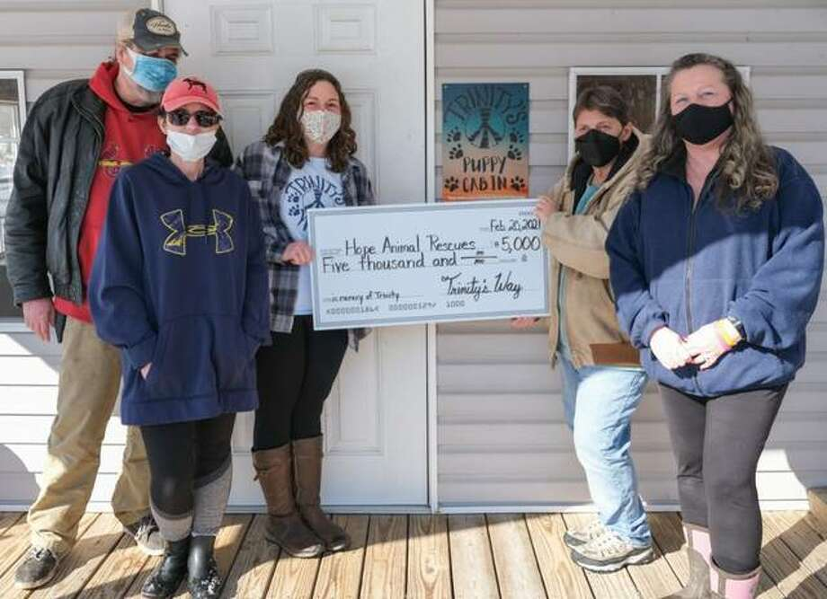 Trinity Way on Saturday made a $5,000 donation to Hope Animal Rescues. Pictured from left are Chris Unthank, Deb Simmerman, April Gray, Jackie Spiker and Diane Giebe.
