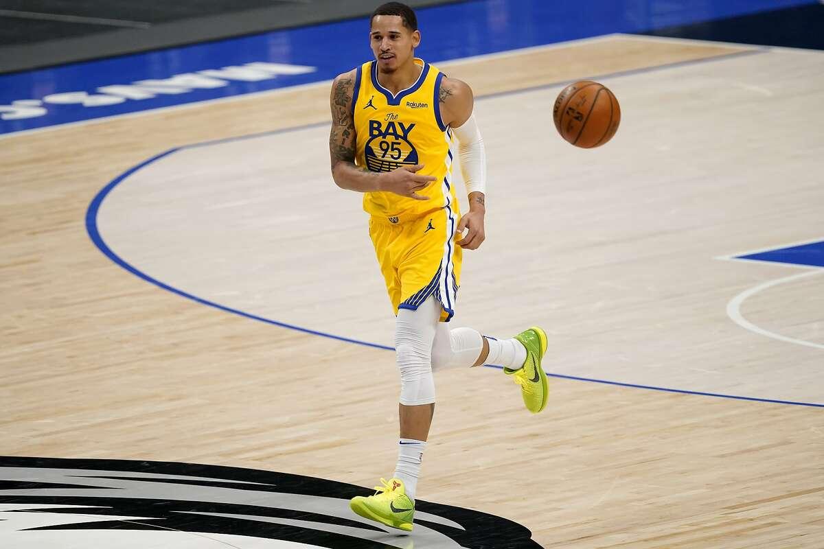 Golden State Warriors' Juan Toscano-Anderson passes the ball during an NBA basketball game against the Dallas Mavericks in Dallas, Thursday, Feb. 4, 2021. (AP Photo/Tony Gutierrez)