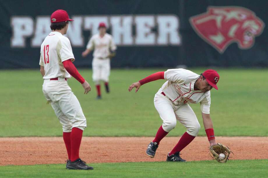 Caney Creek shortstop Alejandro Molina (6) fields a hit by Cole Morris #19 of Montgomery during the first inning of a District 20-5A high school baseball game at Caney Creek High School, Tuesday, April 23, 2019, in Grangerland. Photo: Jason Fochtman, Houston Chronicle / Staff Photographer / © 2019 Houston Chronicle