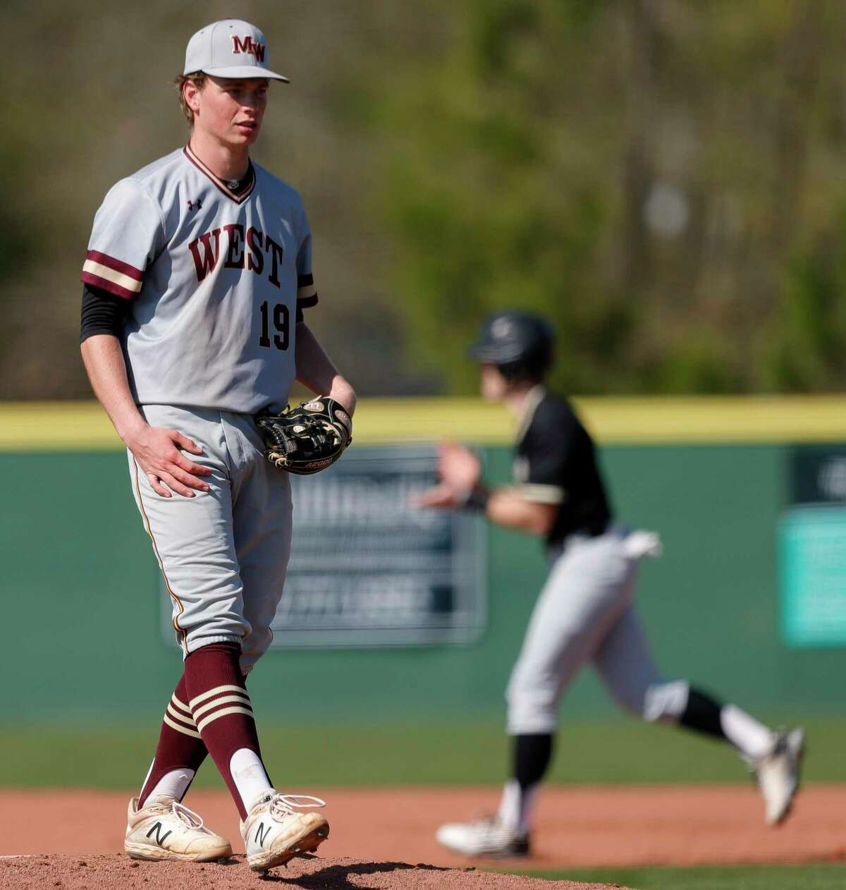 Magnolia West starting pitcher JP Ellwanger (19) is seen after walking Jake Tatom #1 of Porter bases loaded during the second inning of a high school baseball game at Porter High School, Friday, March 6, 2020, in Porter.