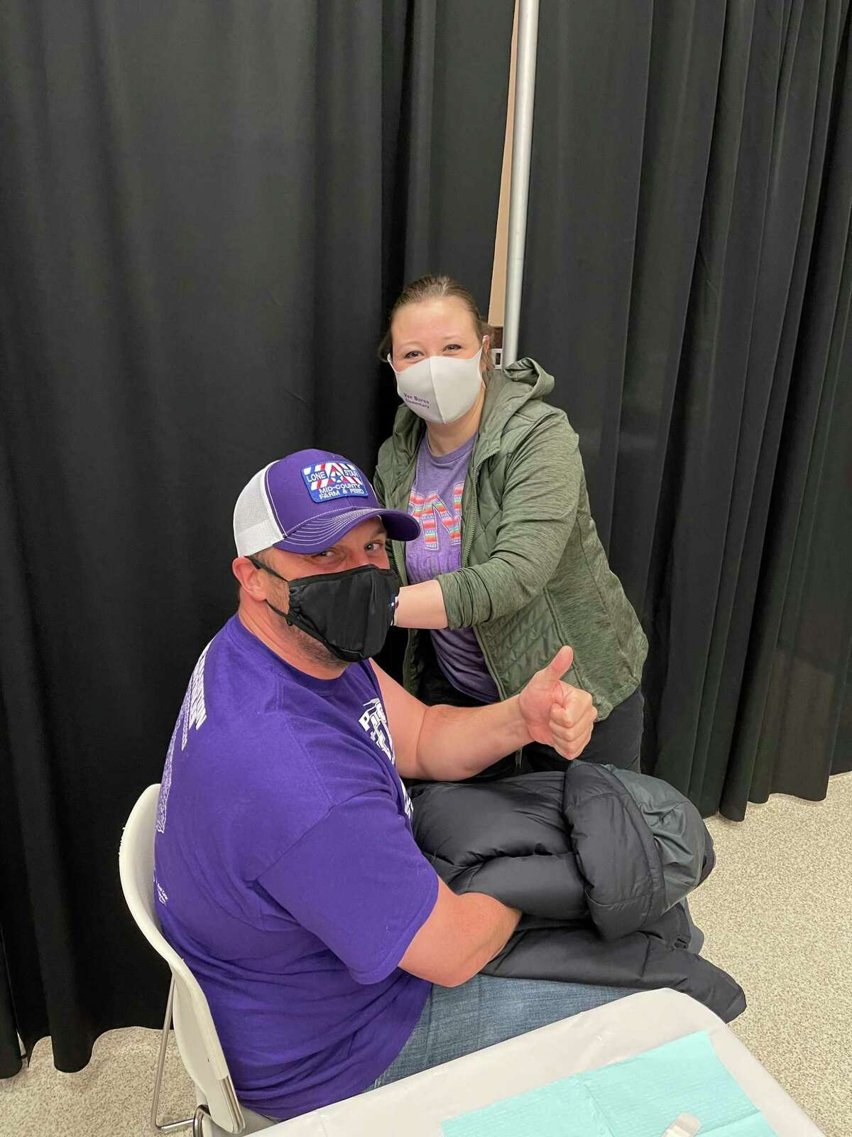 PN-G coach and teacher Charlie Feller receives the Moderna Coronavirus vaccine from Nurse Lauren Ward. The district delayed a vaccine drive due to the ice storm, but were able to proceed during a small break in freezing temperatures on Wednesday.
