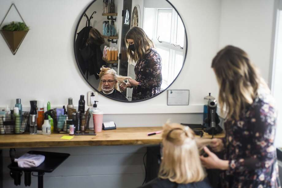 Sam Walser, co-owner of Northwest Hairstyles, works with a client, Barb Patrick, Tuesday, Feb. 16, 2021 at the salon in Midland. (Katy Kildee/kkildee@mdn.net) Photo: (Katy Kildee/kkildee@mdn.net)