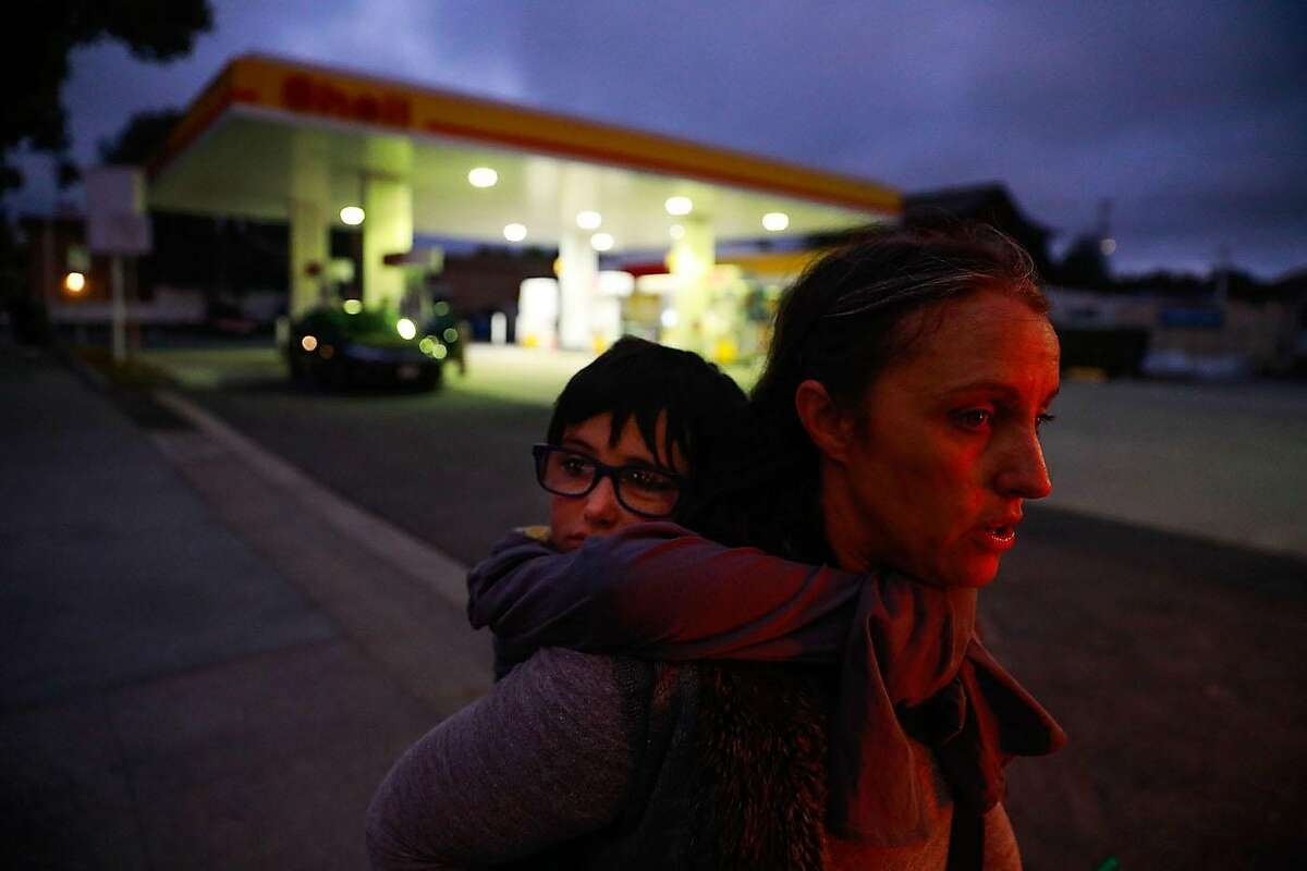 Photographer Gabrielle Lurie captured Theo, a homeless boy, nearly asleep as he rides on his mom Leah Naomi Gonzales' shoulders in Berkeley.