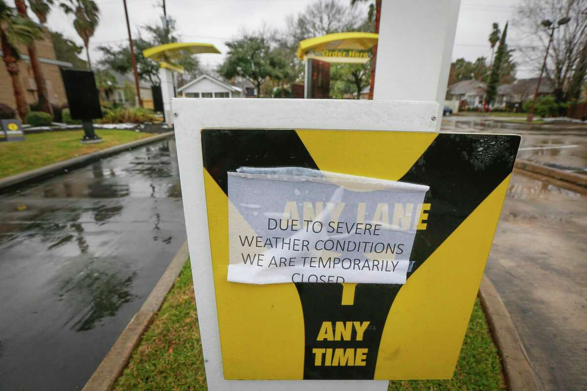 A McDonalds is closed at 3611 N Main St due to severe weather Wednesday, Feb. 17, 2021, in Houston. The winter storm will likely cost the country $50 billion in damage and economic loss, but the brunt of the economic impact will be felt by hourly workers.