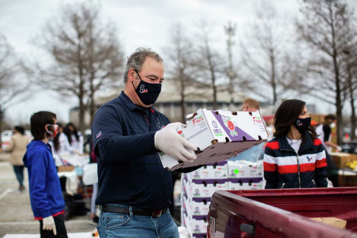 Texans' Cal McNair distribute supplies during the Neighborhood Super Site food distribution event organized by the Houston Food Bank and HISD, Sunday, Feb. 21, 2021, in Houston.