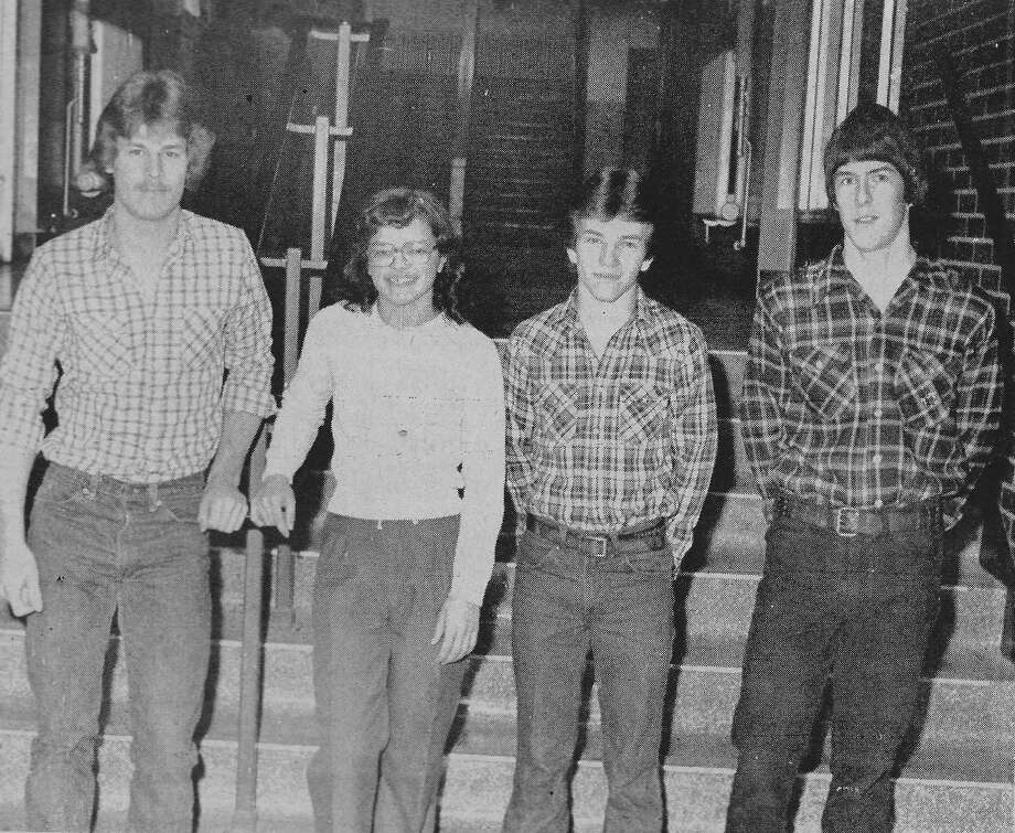 Four members of the Manistee High School ski team received All-Conference honors this season. (From left) Bryan Thomas (slalom team), Tia Badalamente (special merit), Jason Prickett (honorable mention) and John Olson (slalom team). The photo was published in the News Advocate on this day in 1981. (Manistee County Historical Museum photo)