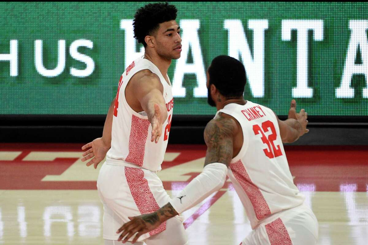 Houston guard Quentin Grimes, left, celebrates his three point basket with Reggie Chaney during the first half of an NCAA college basketball game against Cincinnati, Sunday, Feb. 21, 2021, in Houston. (AP Photo/Eric Christian Smith)
