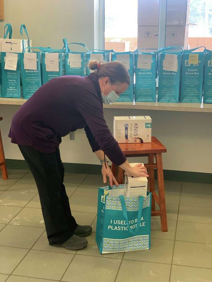 Jessica Carland, mobility manager for Benzie Bus, helps pack masks for a pick-up event held with United Way and Area Agency on Aging. (Courtesy Photo)