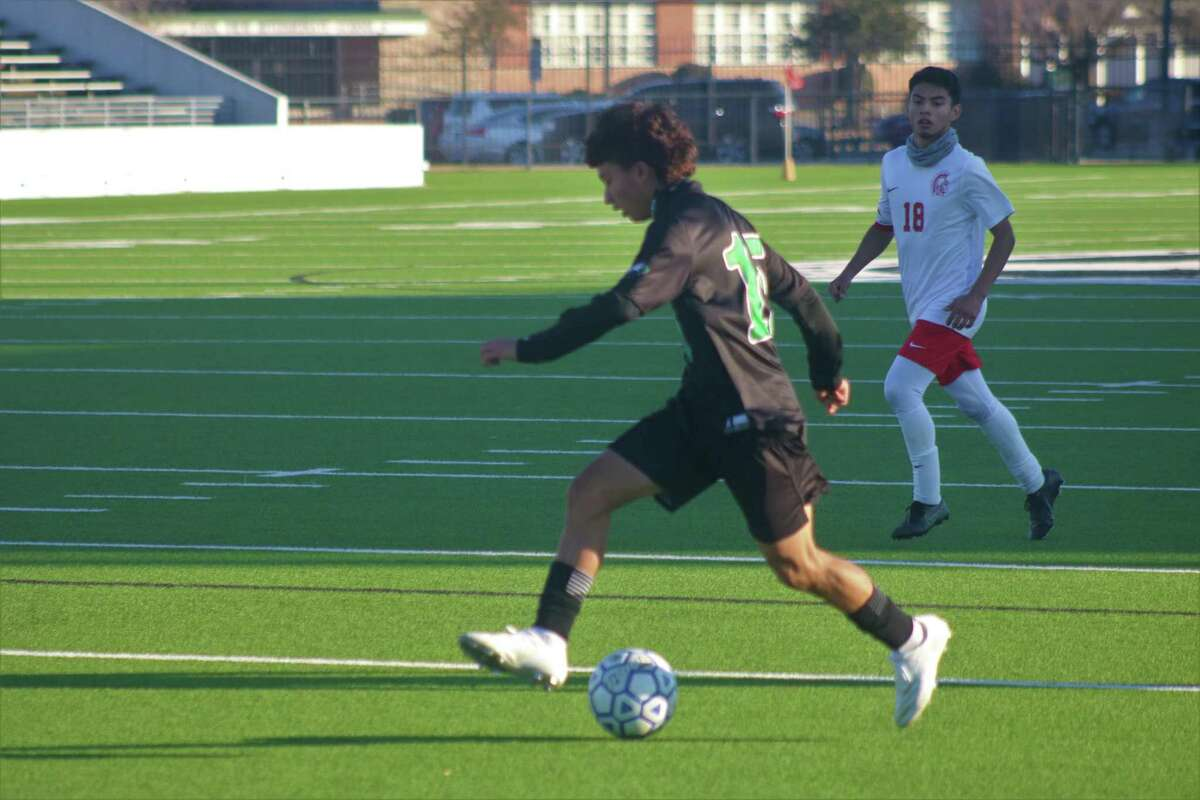 Pasadena's Giovanni Prieto corrals a ball before attempting a shot on goal during second-half action Saturday.