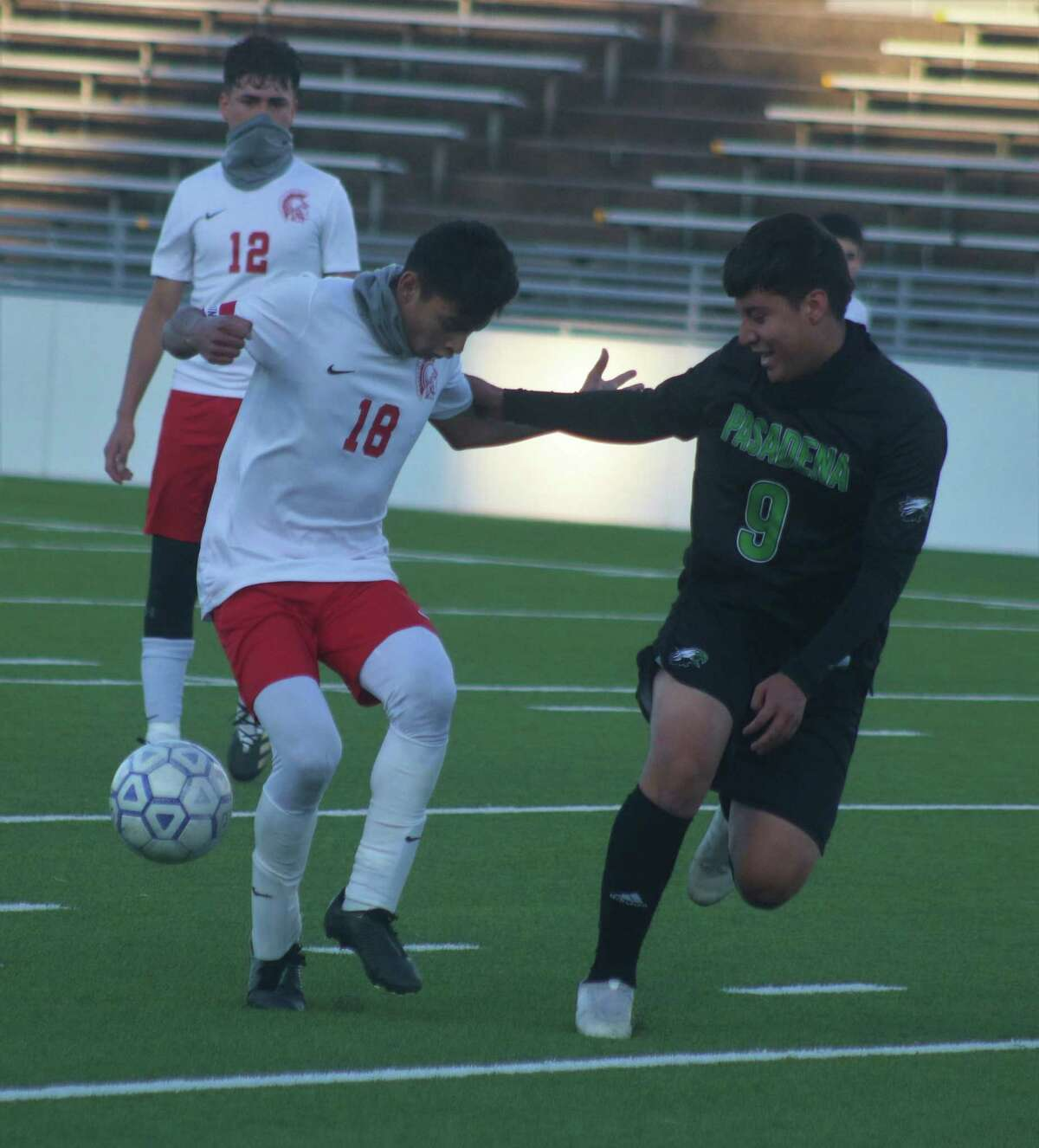 Pasadena's Justin Duran and a South Houston player try to locate the ball at midfield in their 22-6A match late Saturday afternoon.