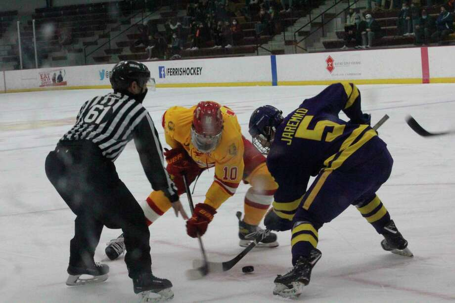 Ferris' Coale Norris (10) battles for the puck on the faceoff against Minnesota State's Jake Jaremko (5) on Saturday at the Ewigleben Ice Arena. (Pioneer photo/John Raffel)