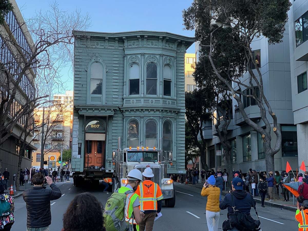 Crews move a Victorian building to its new home.