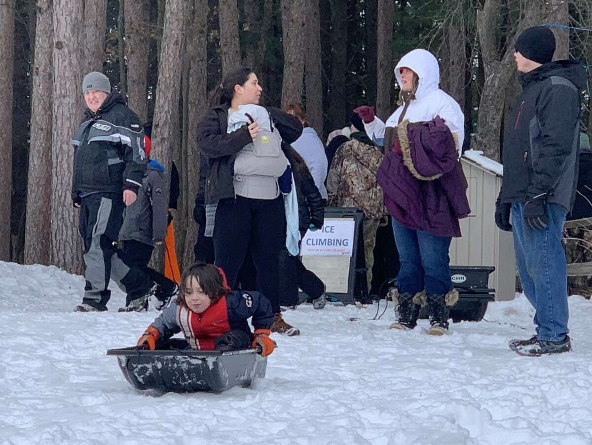 Cars of visitors lined up at the entrance to CranHill ranch to take advantage of a day of winter fun at Winterfest Part II on Sunday. Visitors spent the day ice skating, ice climbing, sledding and playing broomball.