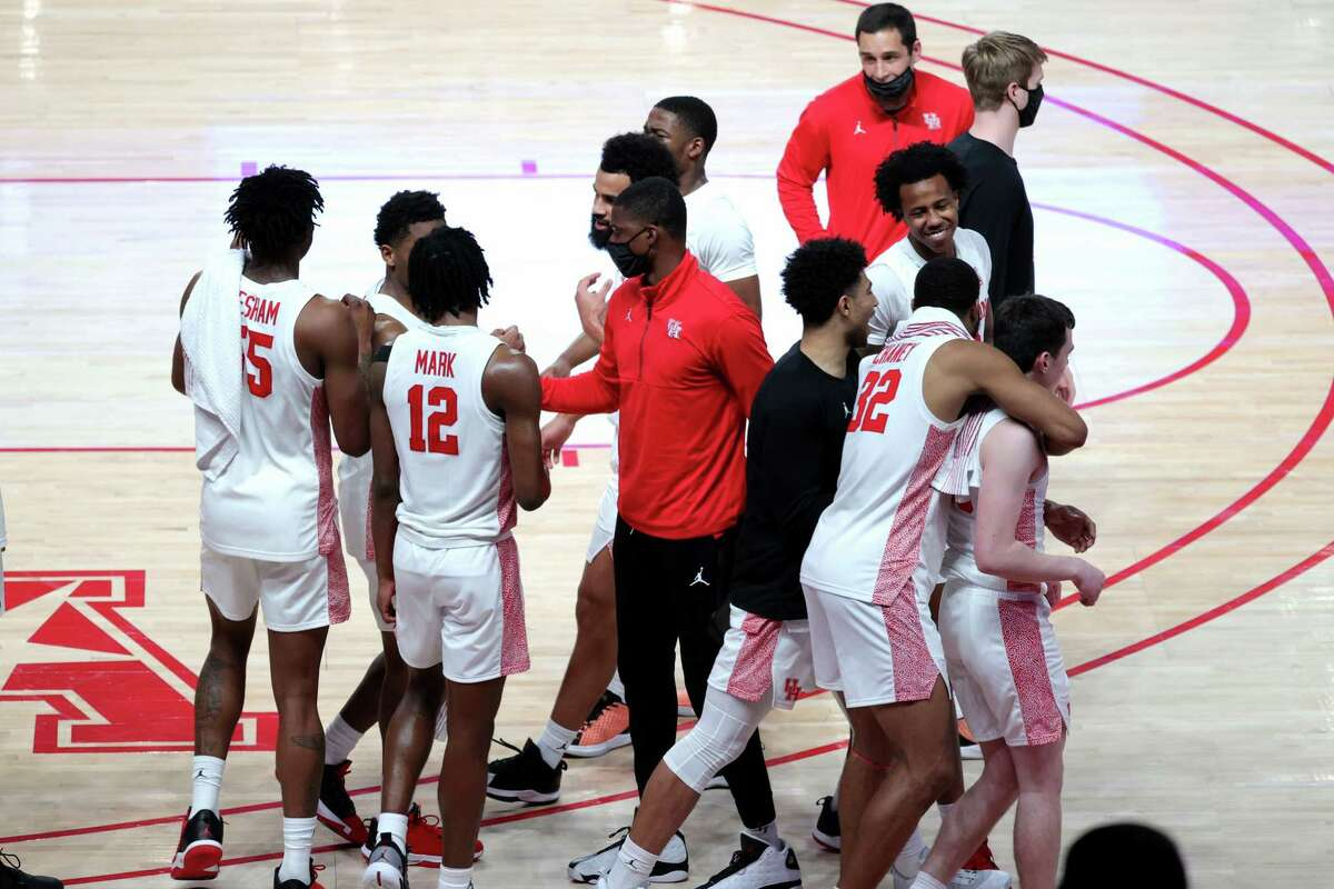 HOUSTON, TEXAS - FEBRUARY 21: Houston Cougars celebrate after defeating the Cincinnati Bearcats 90-52 at the Fertitta Center on February 21, 2021 in Houston, Texas.