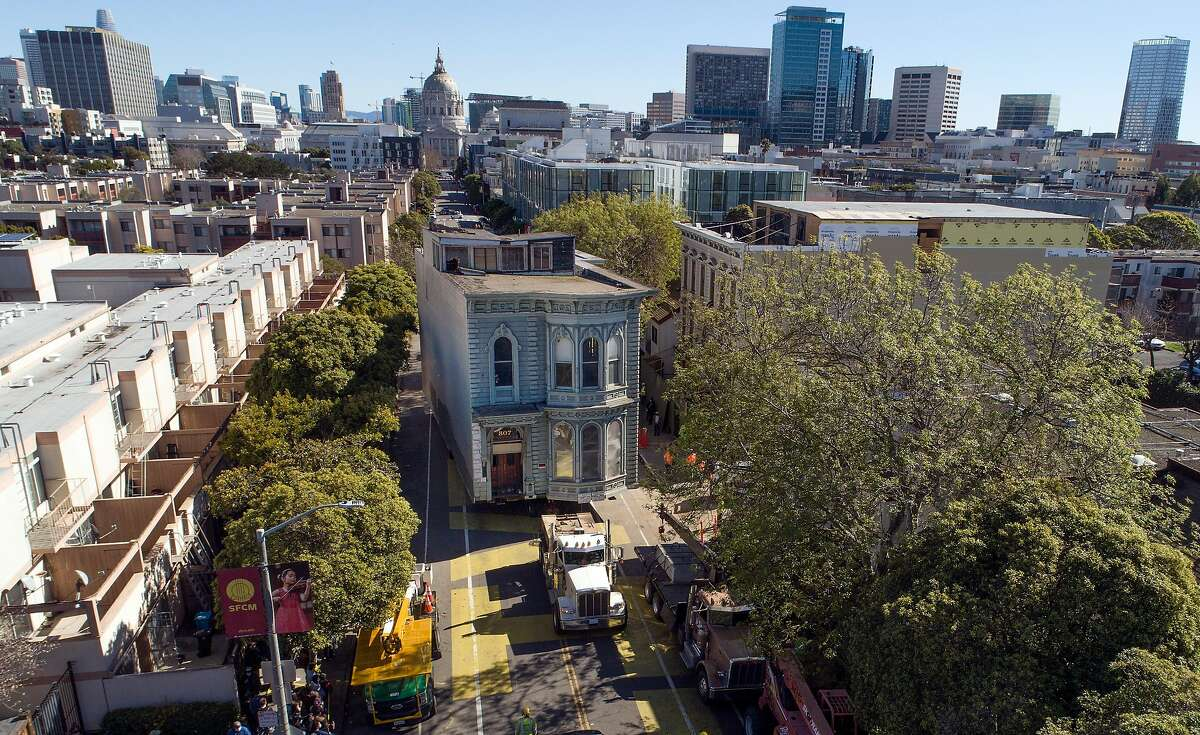 The two-story Victorian Englander Home reaches its new destination as it was relocated from 807 Franklin Street to 635 Fulton Street in San Francisco, Calif., on Sunday, February 21, 2021. The house, known as the Englander House, which was built in 1882, was a historic home and the owner spent years preparing for the move.