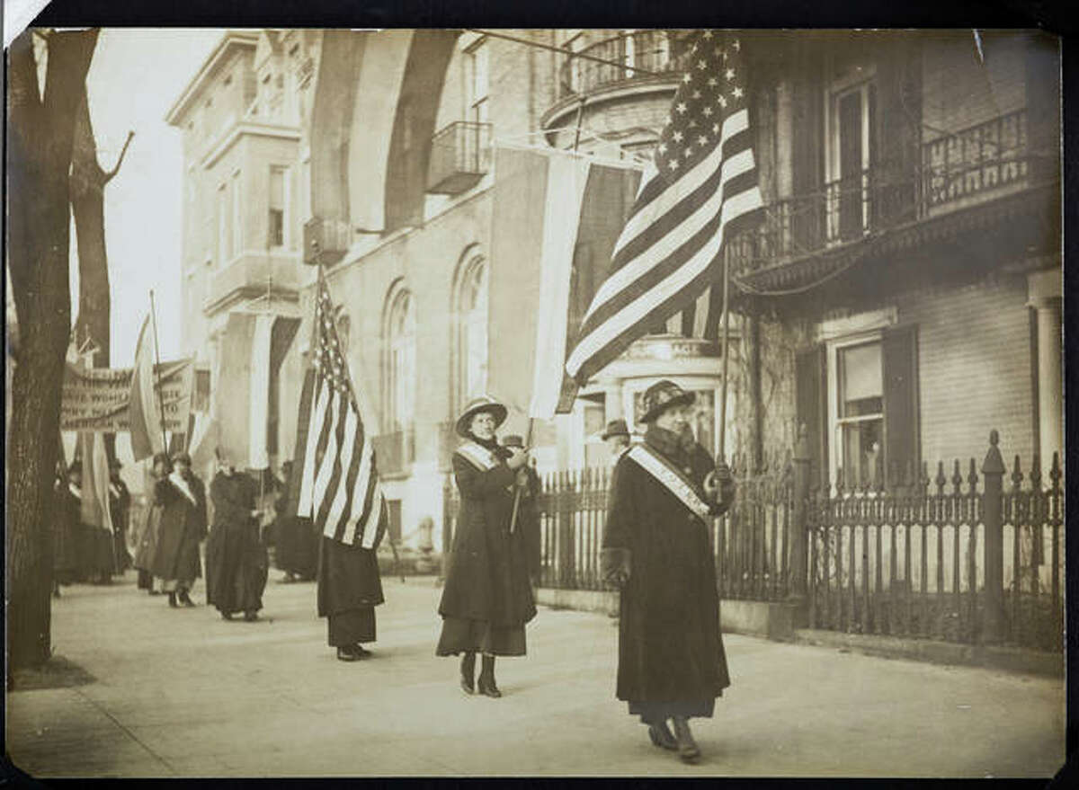 """Women suffragists march in a photograph that is part of """"Voices and Votes: Democracy in America,"""" a traveling exhibit that is part of the Smithsonian Institution's """"Museum on Main Streets"""" program. The exhibit is tentatively set to appear in the atrium of the Madison County Administration Building July 17 - Aug. 21."""