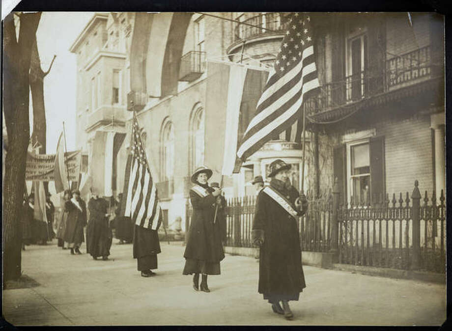"Women suffragists march in a photograph that is part of ""Voices and Votes: Democracy in America,"" a traveling exhibit that is part of the Smithsonian Institution's ""Museum on Main Streets"" program. The exhibit is tentatively set to appear in the atrium of the Madison County Administration Building July 17 – Aug. 21."