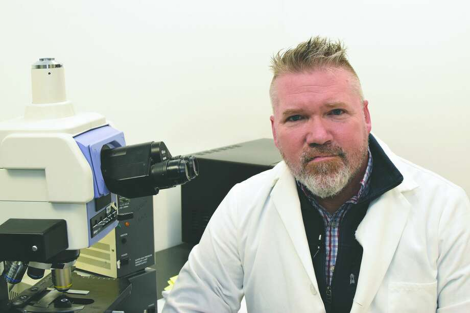 Jeremy Turner works in the laboratory at Turner Scientific in Jacksonville. Photo: David Blanchette | Journal-Courier