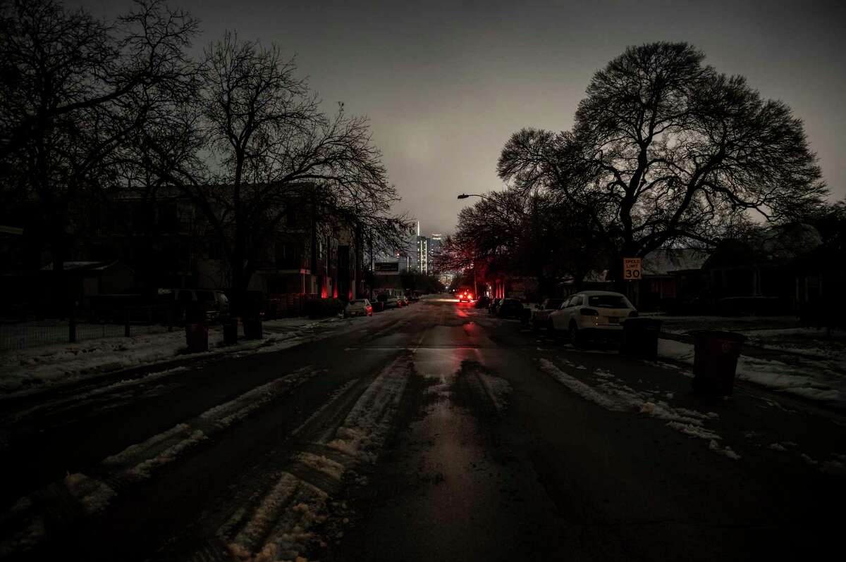 Buildings with power are lit in the distance from an area without power in Austin, Texas, on Wednesday, Feb. 17, 2021.