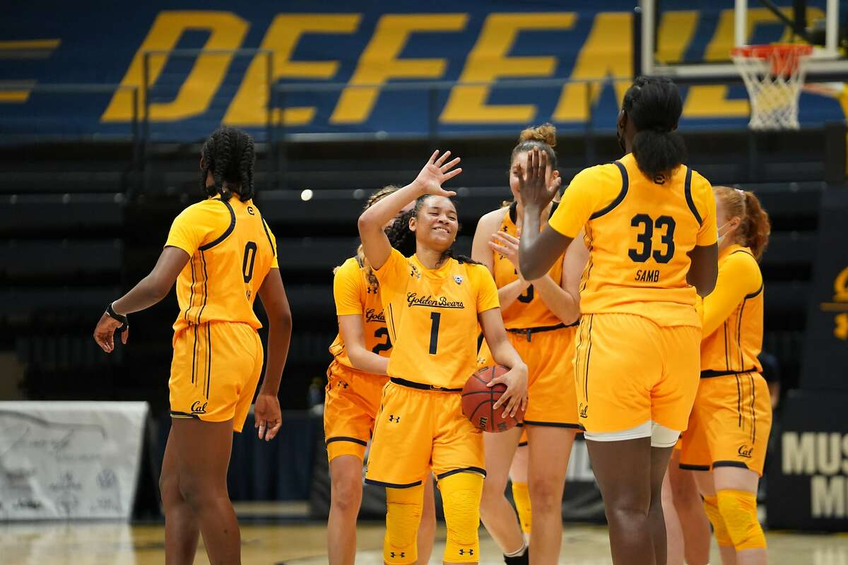 Cal's Leilani McIntosh (1), who scored 21 points, celebrates with her teammates after the Bears beat Arizona State at Haas Pavilion on Sunday for their first win of the season.