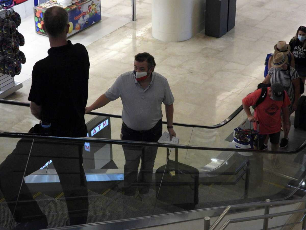 Sen. Ted Cruz checks in at the Cancún airport to return to Texas following outrage over his little getaway. Like other Texas Republican showmen, he failed to lead during this crisis.