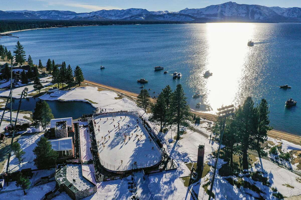 In a view from a drone, the Bruins and the Flyers warm up prior to their game at the Edgewood Tahoe Resort in Stateline, Nev. The game's start was delayed about 20 minutes because of glare.