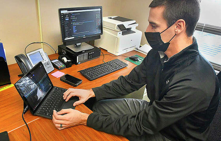 Matt Frahm, youth sports and teen supervisor for the town of Normal, logs in to a gaming site as part of his efforts to build on an esports gaming league. Photo: David Proeber | The Pantagraph (AP)