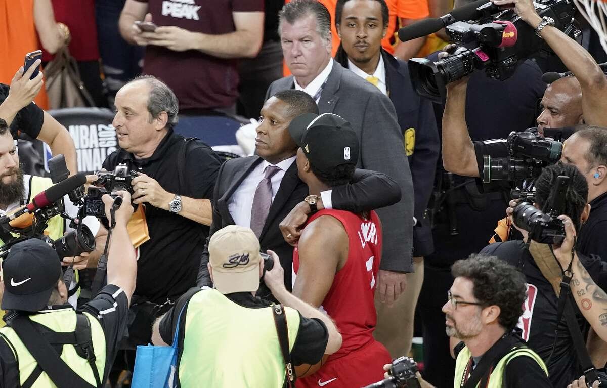 Toronto Raptors President Masai Ujiri walking with guard Kyle Lowry after the Raptors defeated the Golden State Warriors in Game 6 of the 2019 NBA Finals in Oakland, Calif.