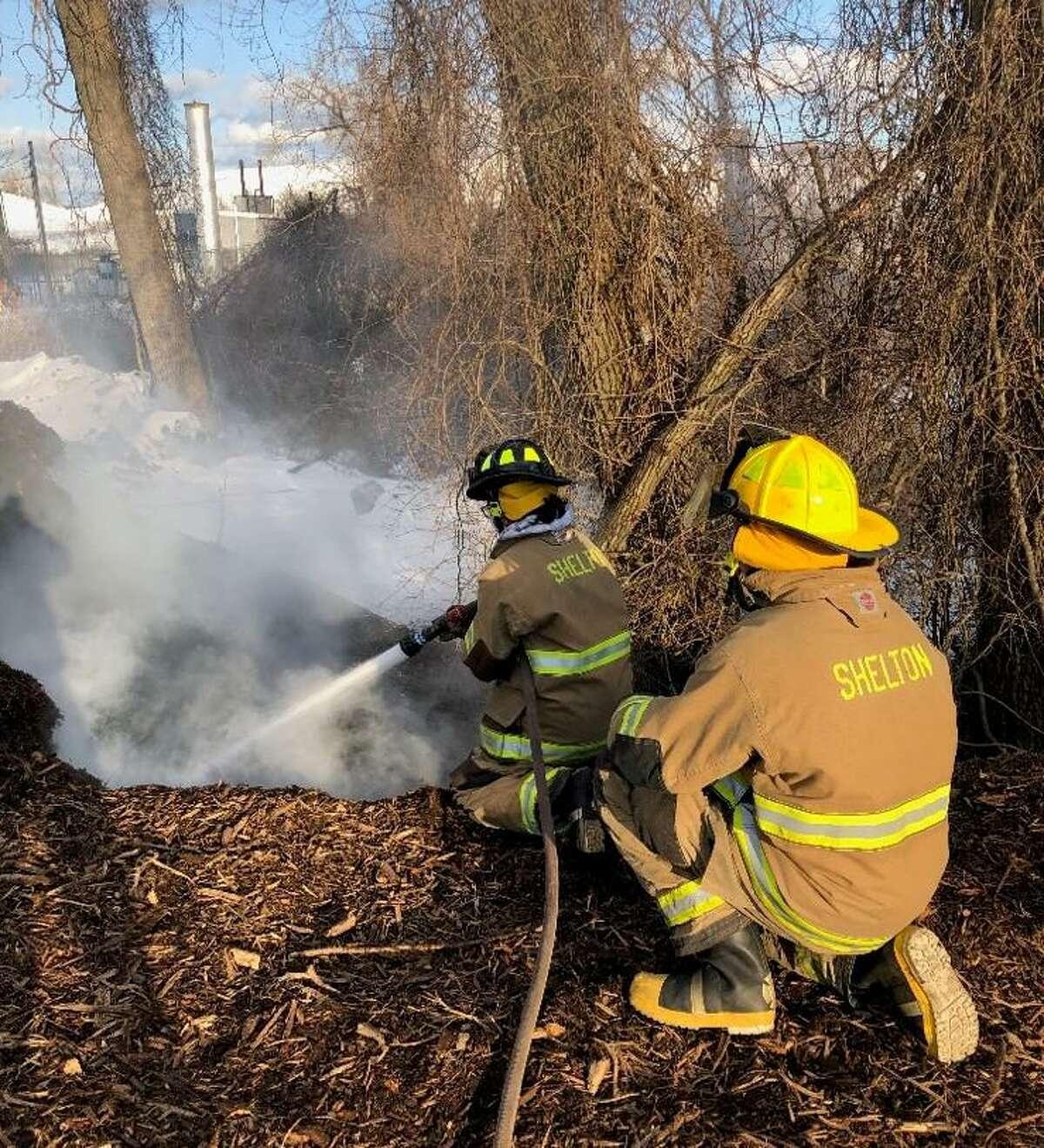 Shelton firefighters battle a mulch fire at the city transfer station Sunday, Feb. 21.