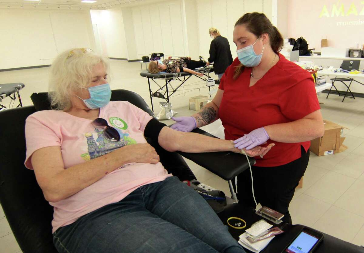 A file photo of an American Red Cross blood drive at the mall in Milford, Conn., on Tuesday July 28, 2020. After recent winter weather in Connecticut prompted the Red Cross to cancel appointments for blood donations, officials are urging those able to donate to do so immediately.