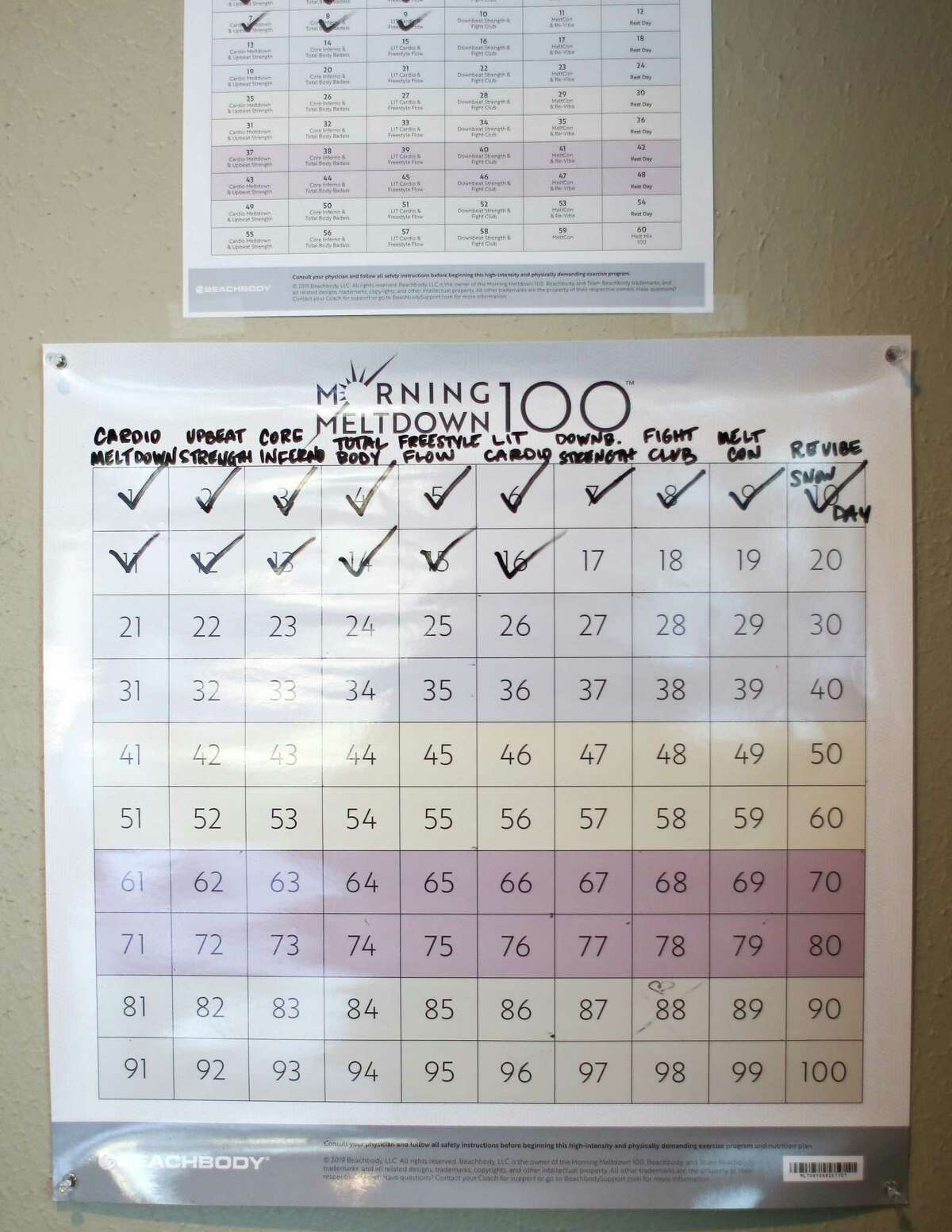 A tracker helps the Smiths tick off their workouts for a 100-day challenge.