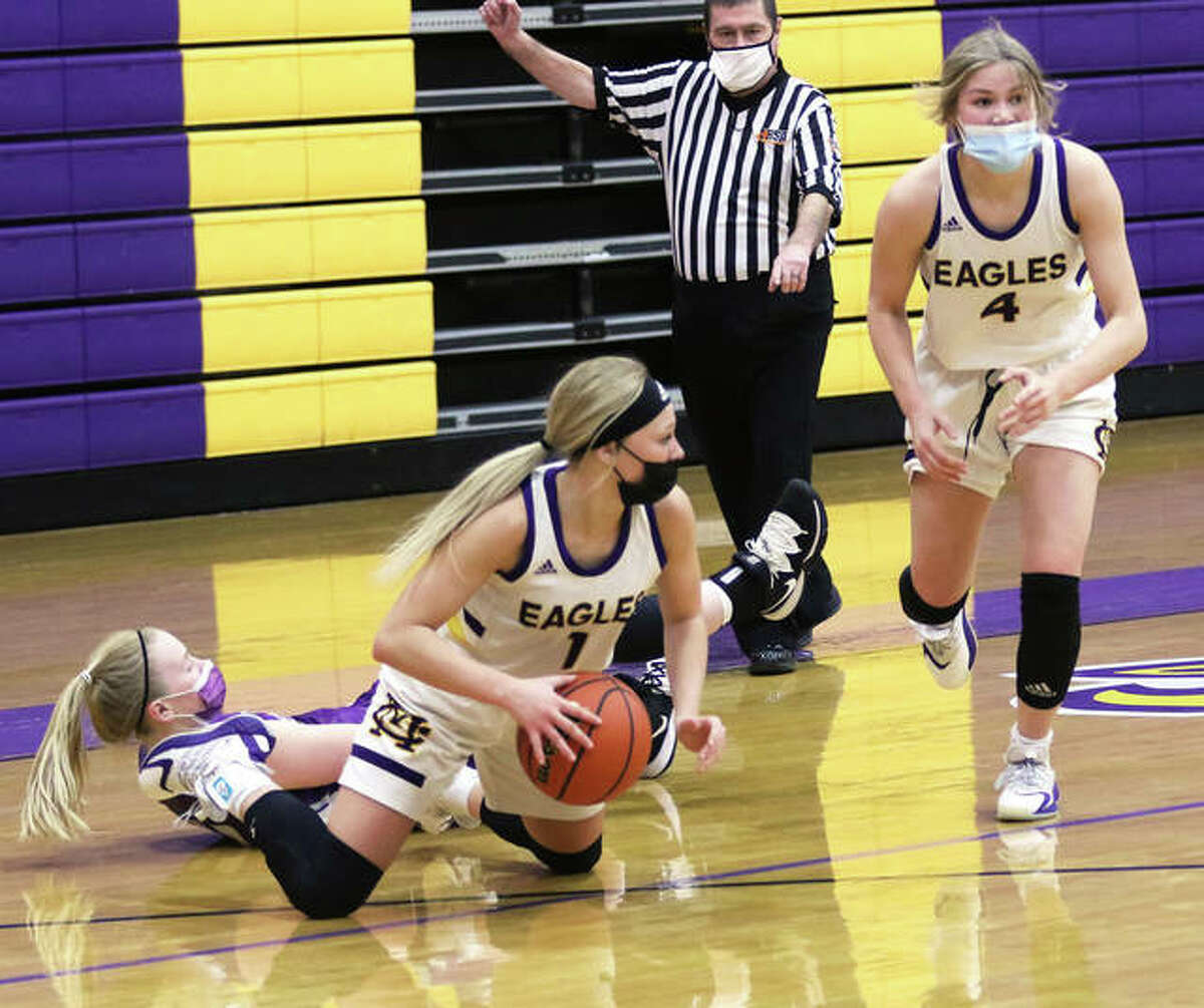 CM's Tori Standefer (1) beats a Breese Central player to a loose ball and looks for a teammate before giving the ball to Maura Niemeier (4) in a Feb. 9 game in Bethalto.