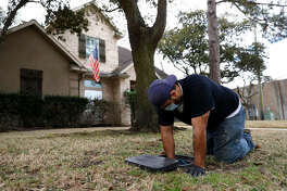 Plumber Randy Calazans with One Call Plumbing turns the water back on after repairing a burst pipe in a home on February 21, 2021 in Houston, Texas
