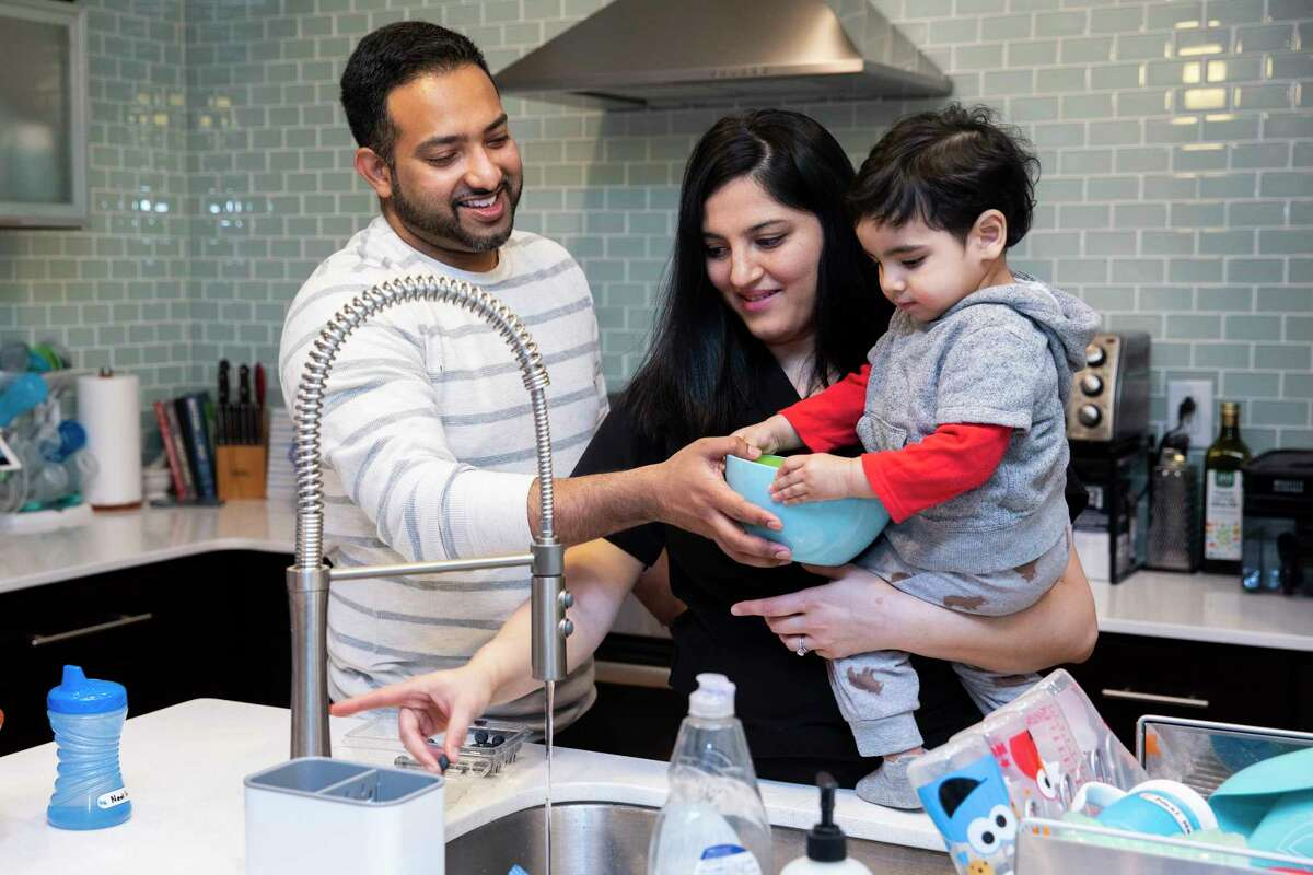 Niharika Sathe, center, an internal medicine physician, is in her second trimester of pregnancy. She decided to get the coronavirus vaccine after investigating false reports that it was linked to fertility issues.