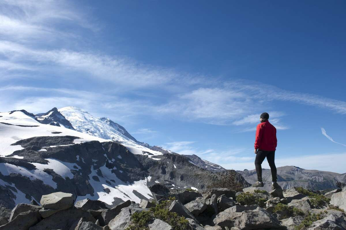 A climber looking at Mt. Rainier.