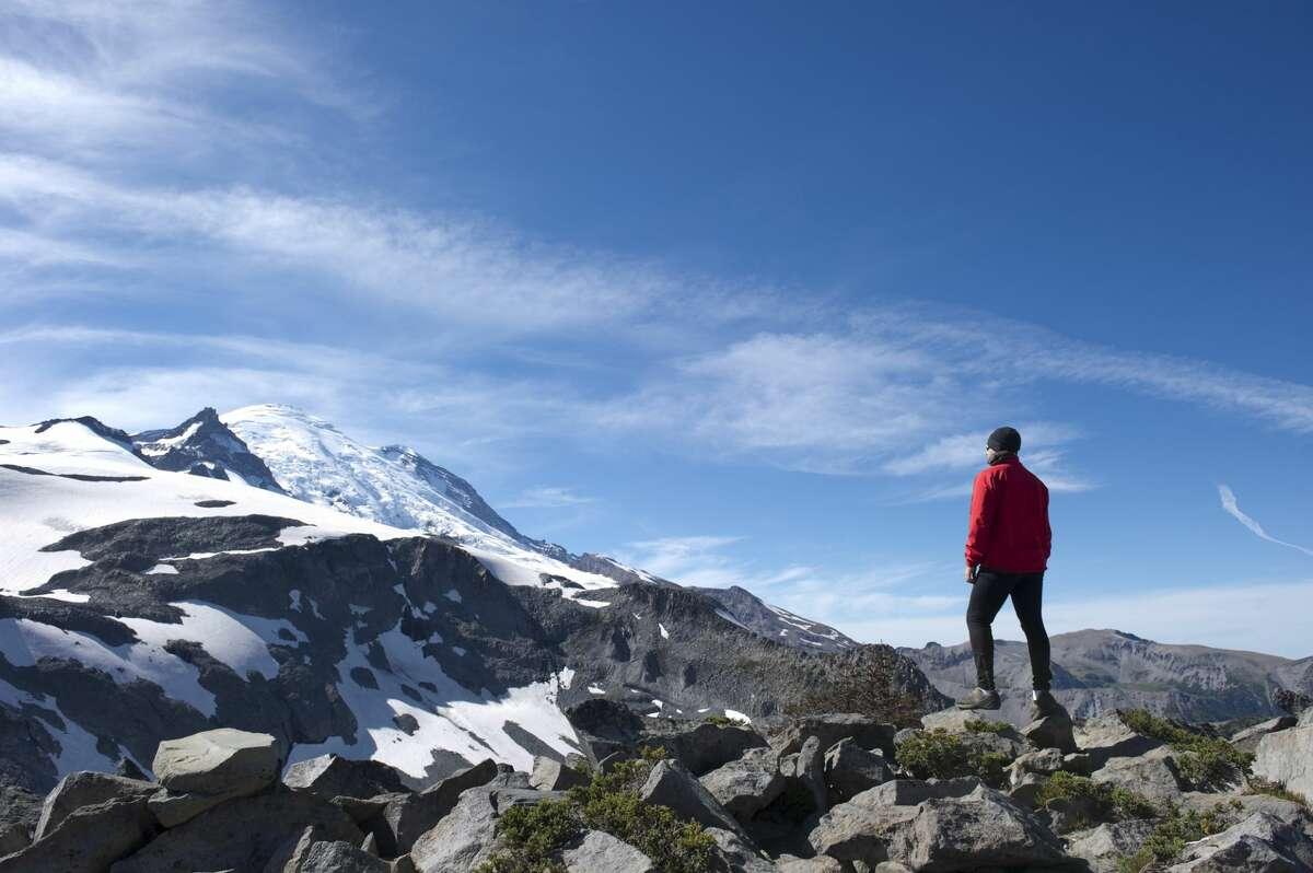 A climber looking at Mt. Rainier.