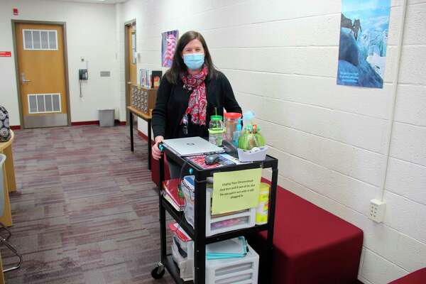 Candie Feltner, a middle school math and english teacher with Caseville Public Schools. Feltner carries her supplies on a cart in between classes, which all Caseville teachers have to do this year. (Robert Creenan/Huron Daily Tribune)