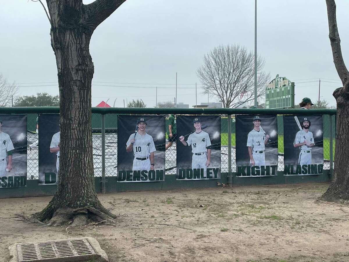Posters of the Stratford baseball players line the outside of the right field fence at the school's baseball stadium