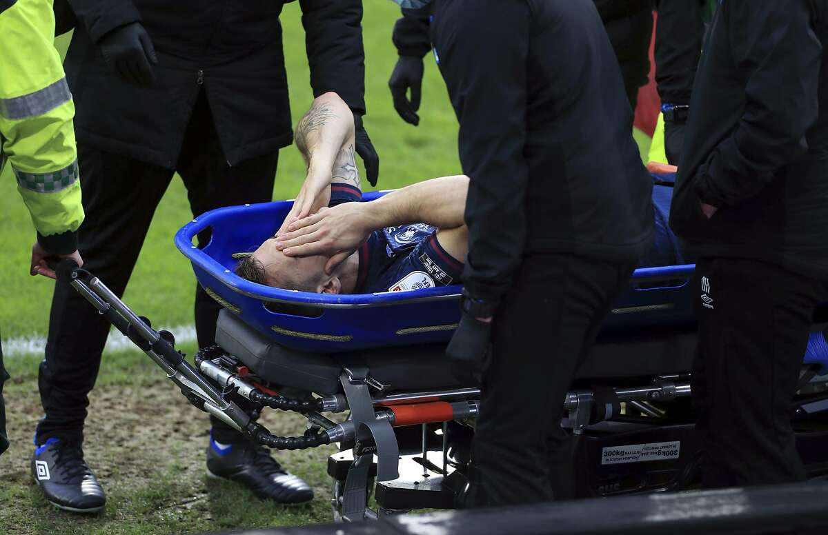 Swansea City's Jordan Morris, a Stanford alum, is stretchered off the field after tearing his ACL in Saturday's match. He will miss the rest of the English season and likely the first eight U.S. World Cup qualifiers, which start in September.